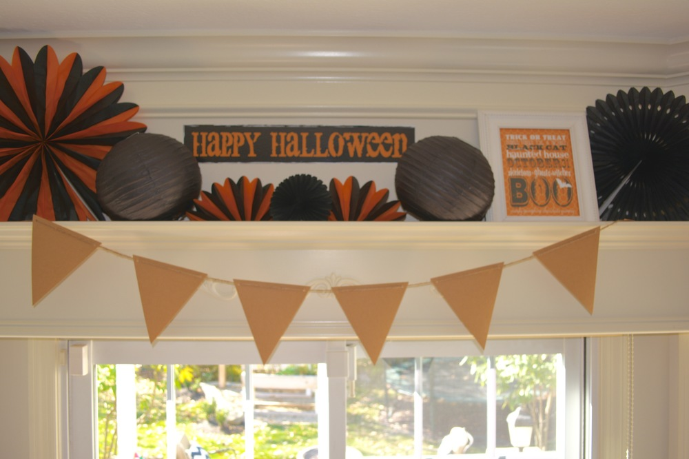 Above our glass door to the back yard, Lance built a large window cornice that I often decorate for holidays and birthdays.