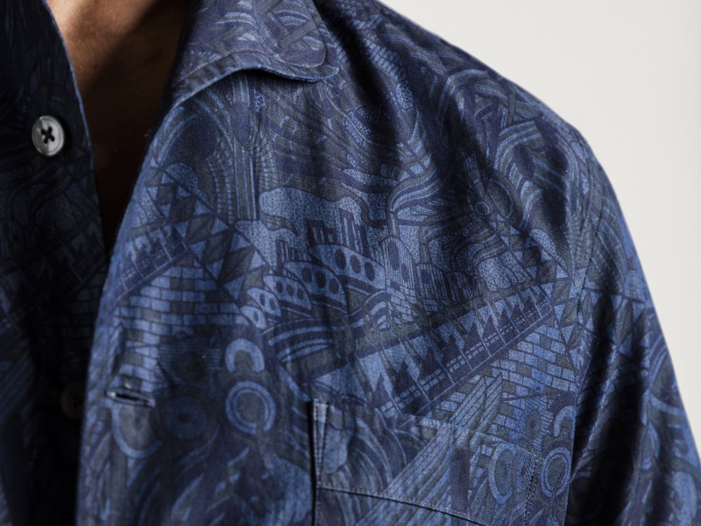 Turnbull & Asser + The Rake Denim Shirt  The third piece of this ongoing partnership between The Rake, Turnbull & Asser and Mo Coppoletta. A series of three denim shirts printed with a pattern inspired by the industrial Victorian docks and factories.   LEARN MORE...