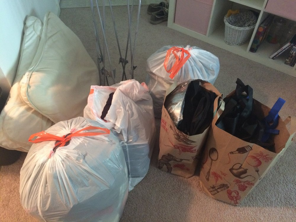 a big batch of stuff that went to goodwill (except they wouldn't take the butterfly chair?! so that went on Craigslist)
