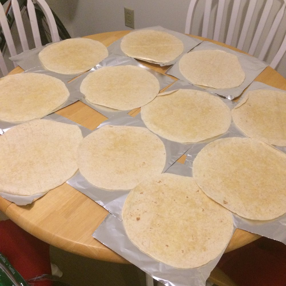 Meanwhile, Prepare The Tin Foil Tear Off 16 Squares Of Toil, And Then Lay  Out All Your Tortillas On The Tin Foil I Have To Use My Kitchen Table And  A Book