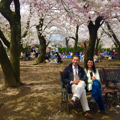 Anisha and Master Ou traveling in Japan during Cherry Blossom season