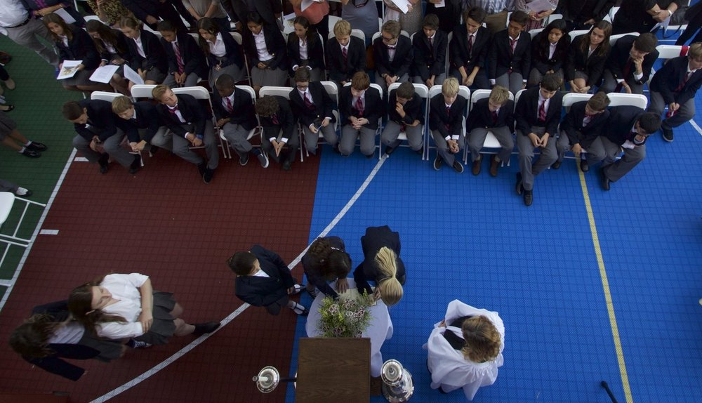 Aerial view of new students signing the Honor Code at Convocation 2015.