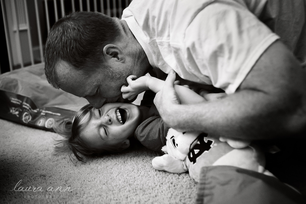 candid black and white photo of father and son by cary photographer