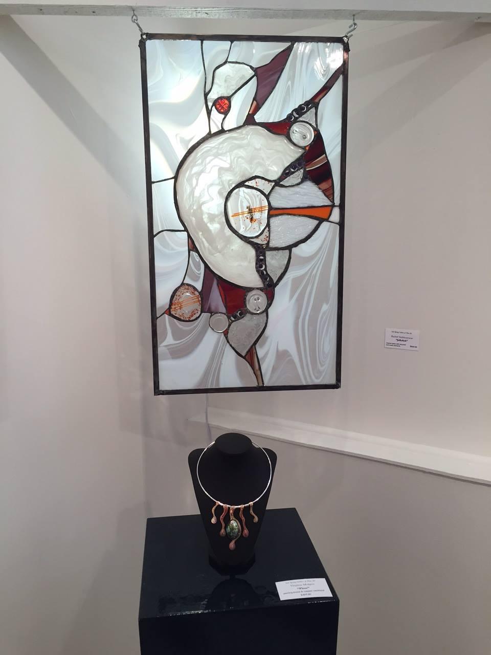 The glasswork of Rachel Vadeboncoeur and the flowing necklace of Virginia Midgett.