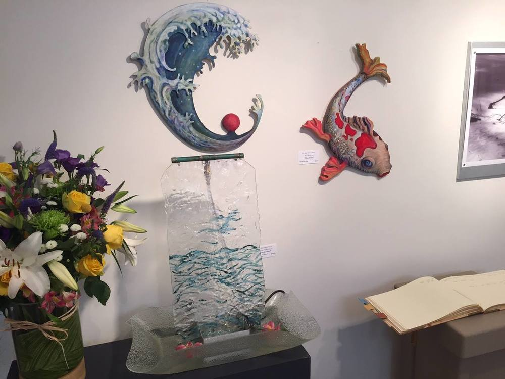 The glass table fountain created by Rachel Vadeboncoeur and two hand-painted wall sculptures by Ken Ketchum.