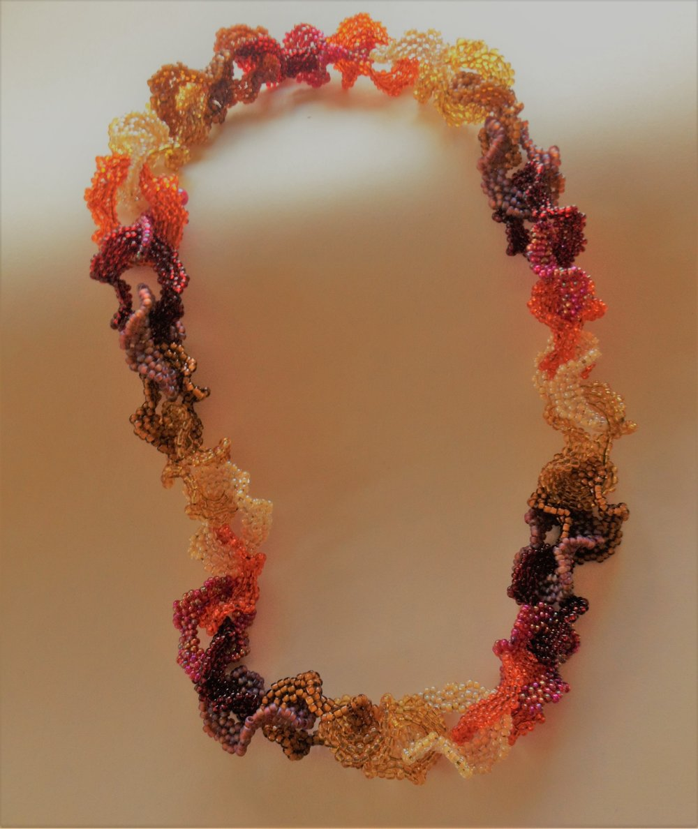 """CAROL NEWMEYER Falling leaves necklace 18"""" Glass Beads $100.00"""