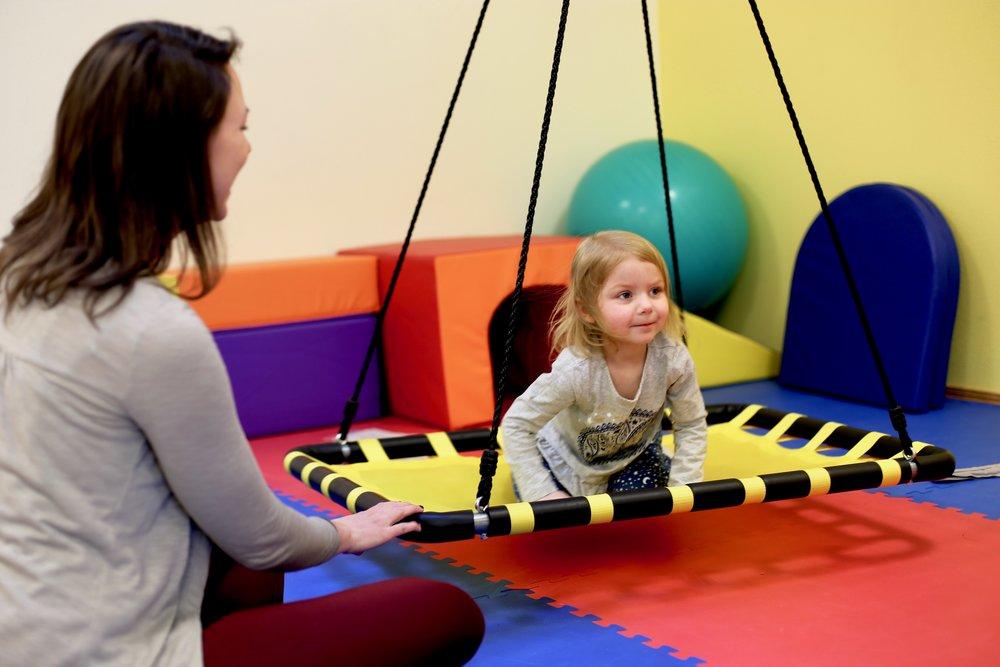 ATC child on swing.jpg