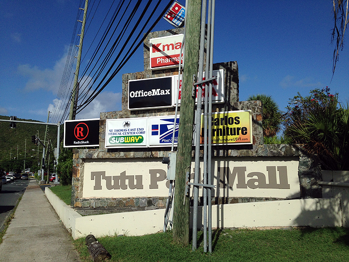 The illustrious Tutu Park Mall.  Not sure if the sign or the telephone pole came first.