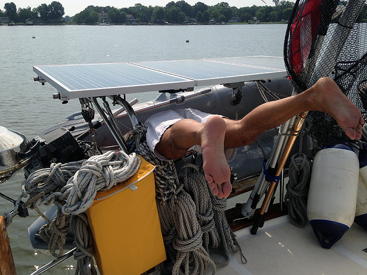 Inserting the transom plug in the dink, a.k.a. Boat Yoga