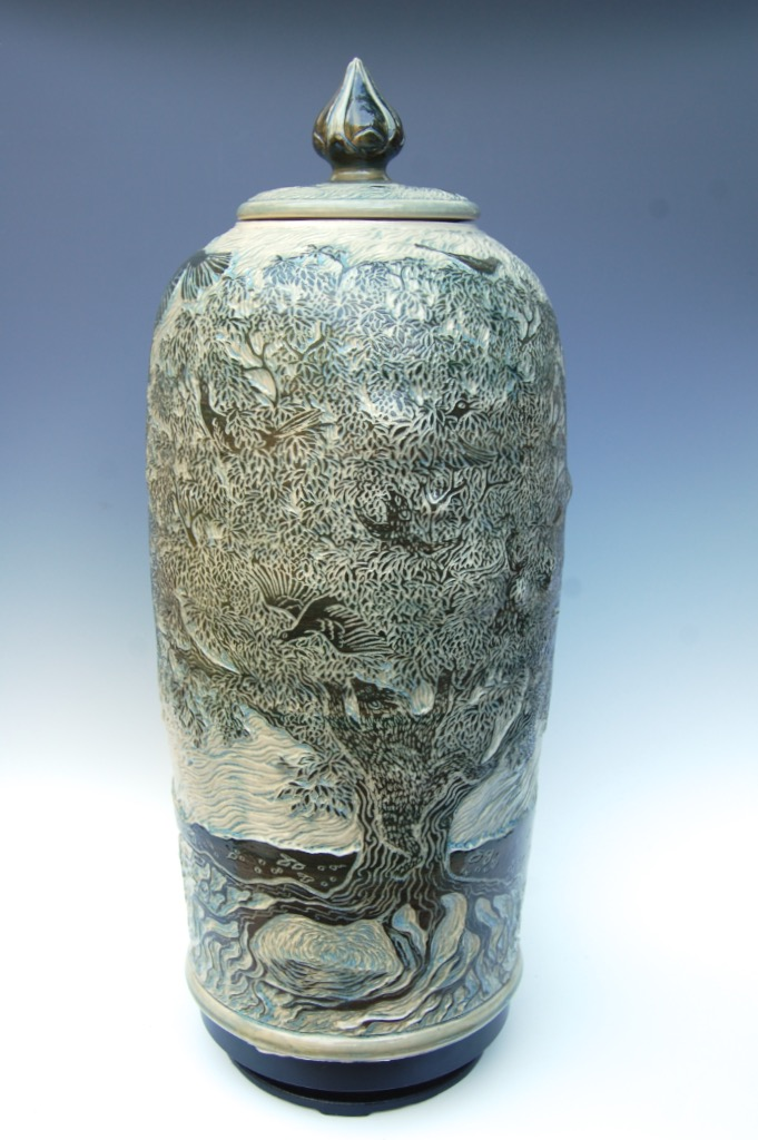 Color-9  Porcelain with dark green englobe slip sgraffito and clear teal glaze