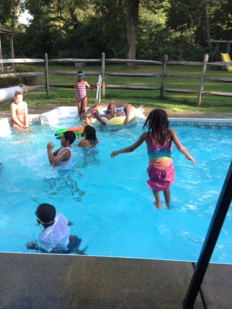 Participants in the Five Days with Mom program take a break on a hot summer afternoon.