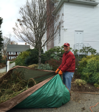 A member of our St. Francis Guild readying the borders for the winter.