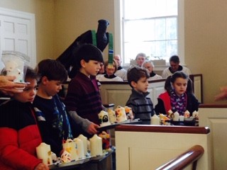 Displaying decorated candles to be blessed at Candlemas