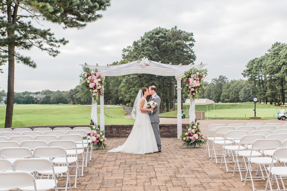 Blue Heron Pines Wedding Ceremony Kiss