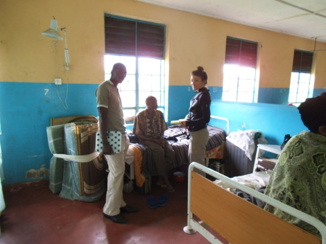 With Patients In A Rural Ugandan Hospital  / Photo Courtesy Of Vanessa