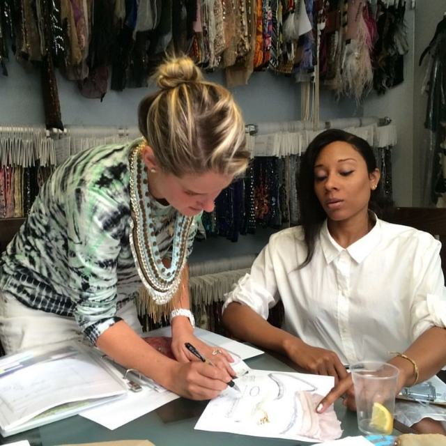 Mignonne seen here submitting designs to her good friend and longtime embroidery agent, Najlah El Amin / Photo courtesy Mignonne Gavigan