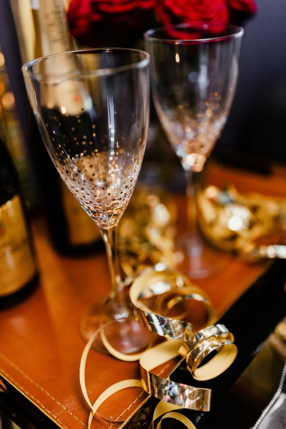 kaboompics_New Year's Eve party - bottle of champagne, glasses & red roses (1).jpg