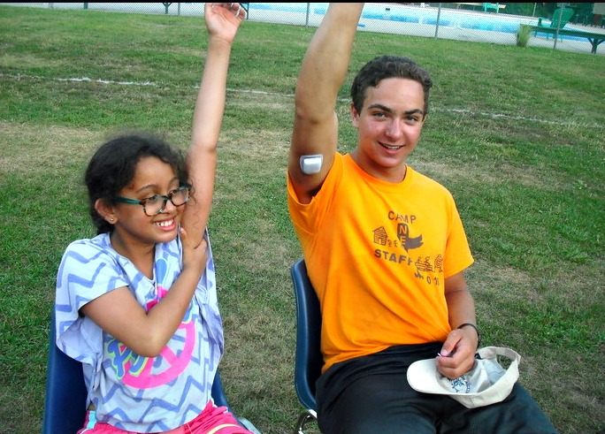 Nejeda counselor, Jack Aiello, with Nejeda camper Star Gentile having fun at summer camp.