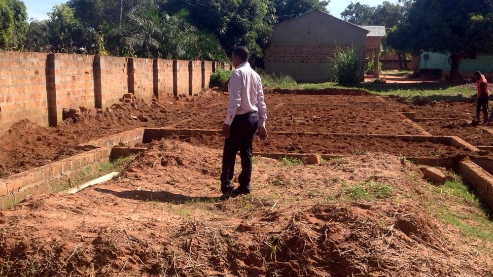 Good Sam—Joseph looking at foundation.jpg