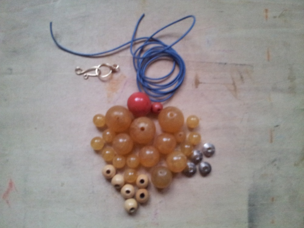 Materials: Leather cord, various beads and hook closure