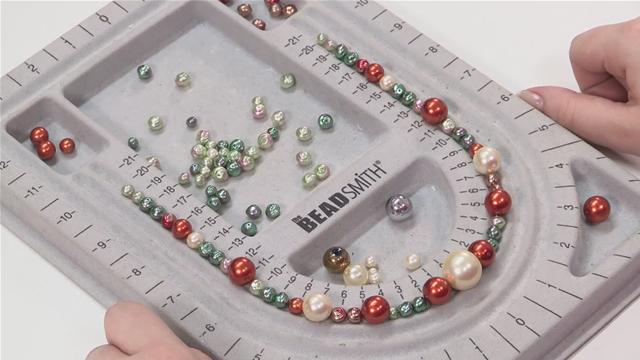This isn't mandatory, but it's great to use a bead board to plan out jewelry designs before you start stringing things together.