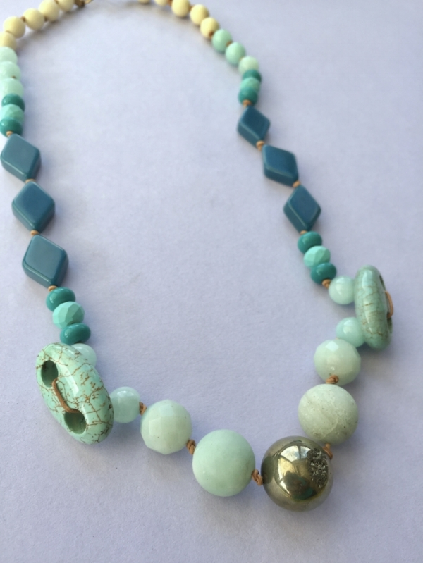 Pyrite centerpiece flanked by amazonite, turquoise, and upcycled beads.