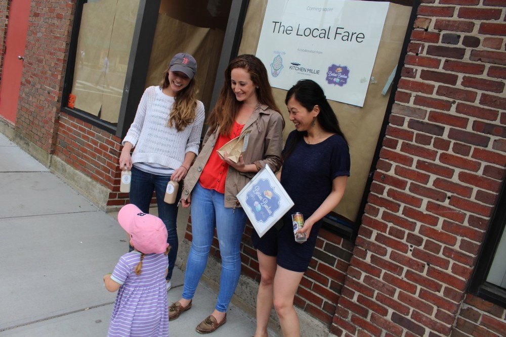 Caroline of nutty life, michelle of kitchen millie, and rita of boston bonbon talking to our very first local fare fan (photo courtesy of scout magazine)