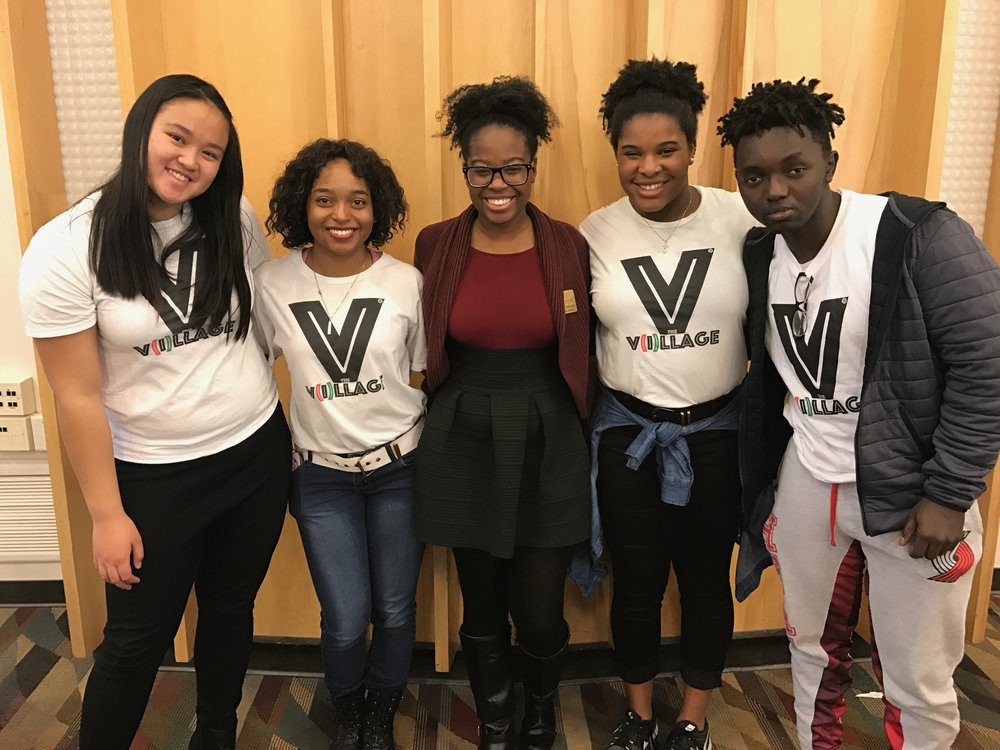 Pictured here are  The V(i)llage ™ Ambassadors Janet Tran, Tierra Yancey, Alexis Baker and Patrick Muvunyi standing with program coordinator Natalie Pinkney. They are attending STEM U, our College Immersion Tour (2017) to  the University of Utah. This annual event is an educational program designed to expose middle, junior and high school students to professions in the fields of science, technology, engineering, and math.