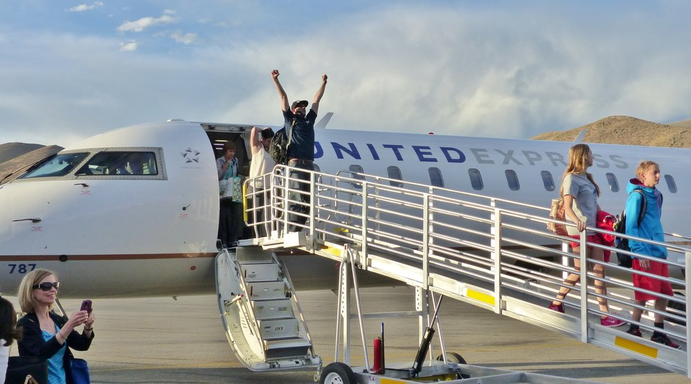 United DEN flight passenger celebrates. Credit Carol Waller 2014.JPG