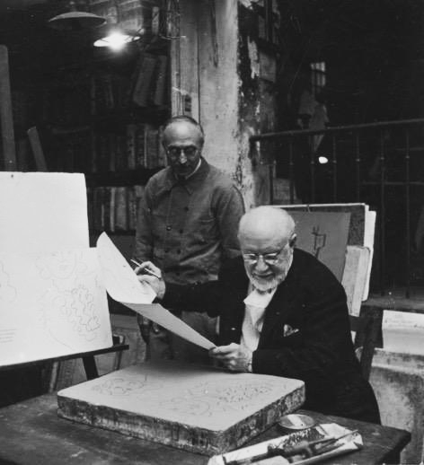 Henri Matisse working on a lithograph at Mourlot