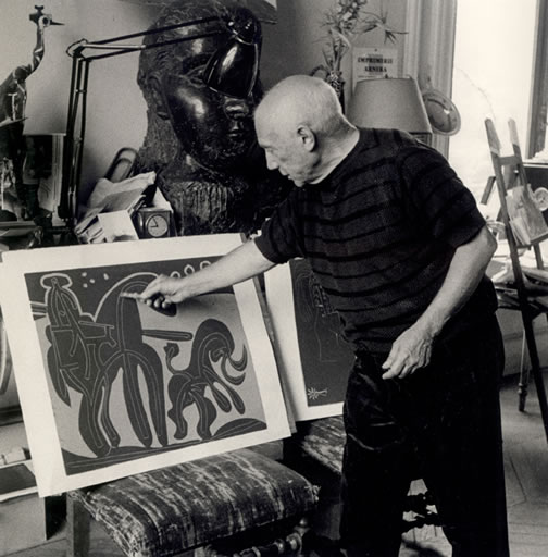 Pablo Picasso working a print