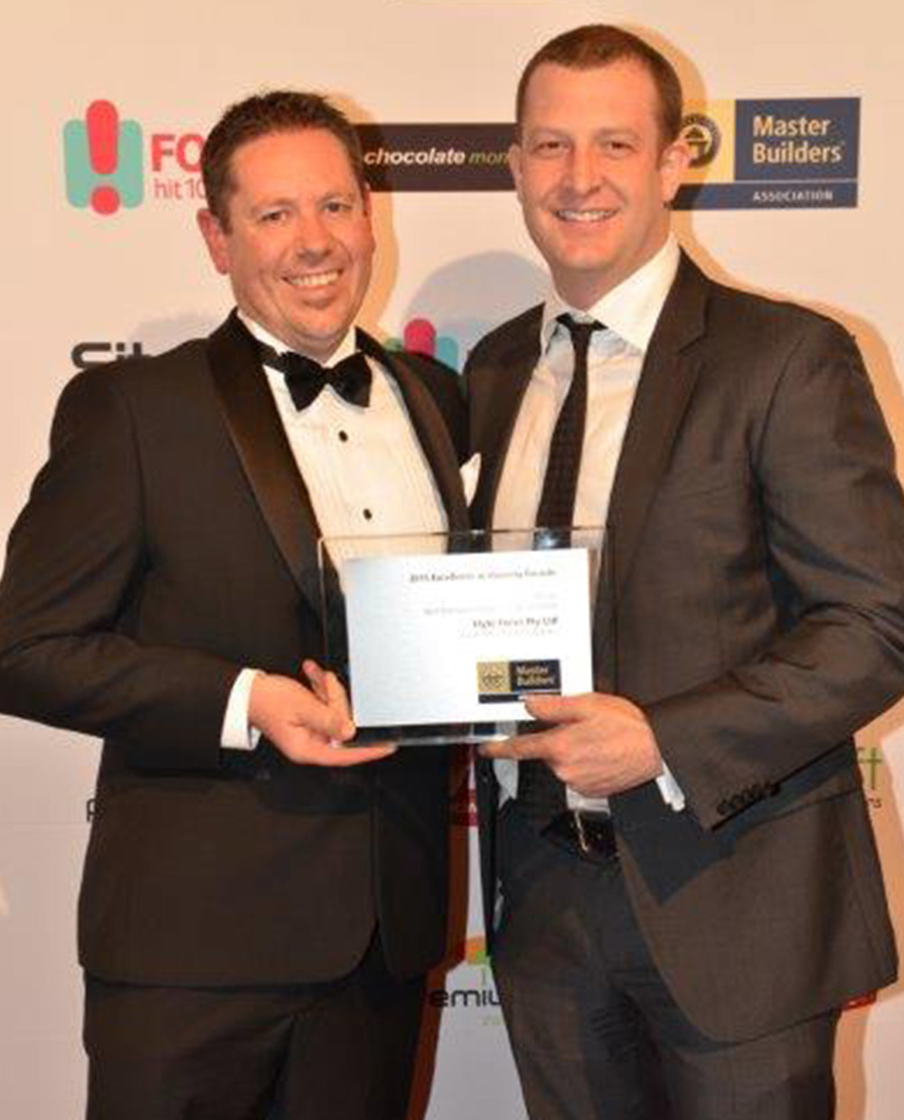 Pete Furlong (right) of Elyte Focus receives the award from Craig Flenley of Crowther Blayne.