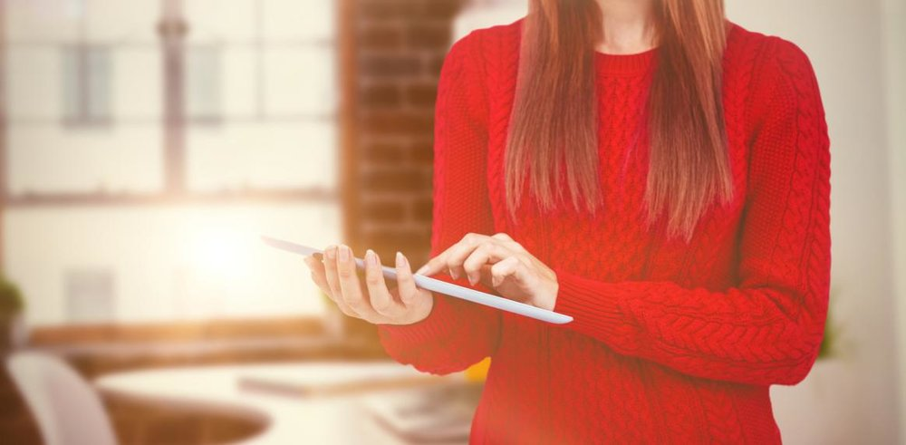 composite-image-of-mid-section-of-a-hipster-woman-using-her-tablet.jpg