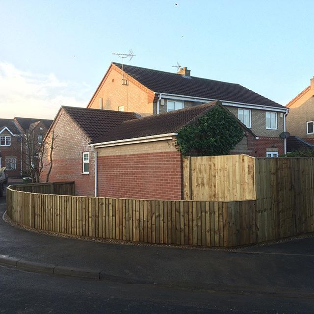 And after  Feather board fencing with hidden double gate