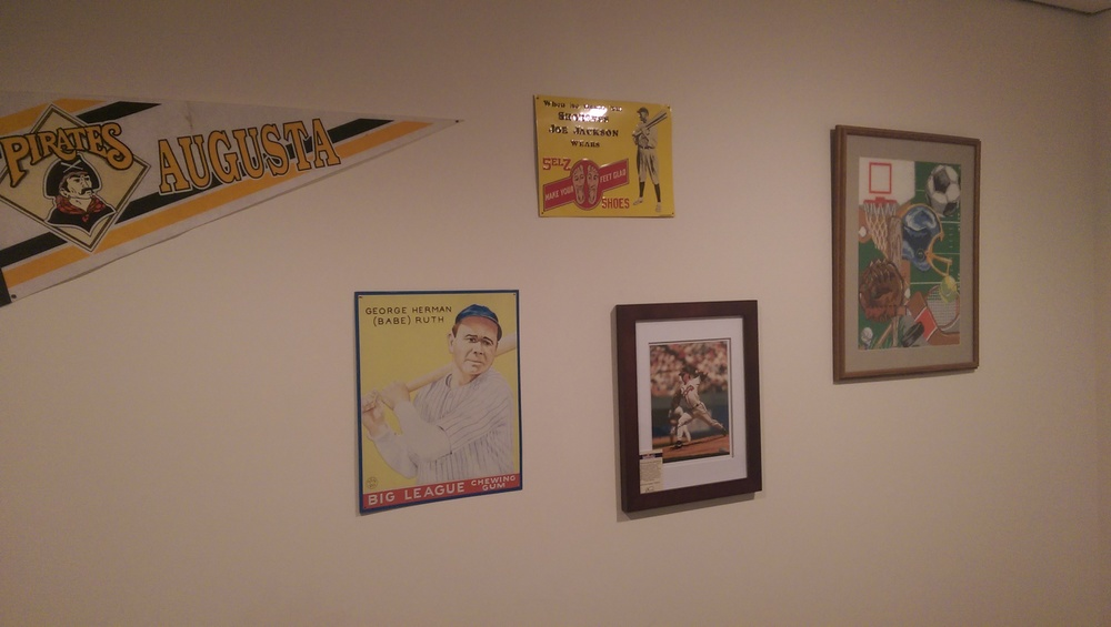 Our basement baseball wall. I could always use more stuff to add to this wall.