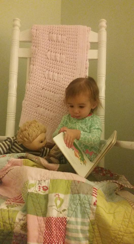 Cece and Geoffrey reading a book.