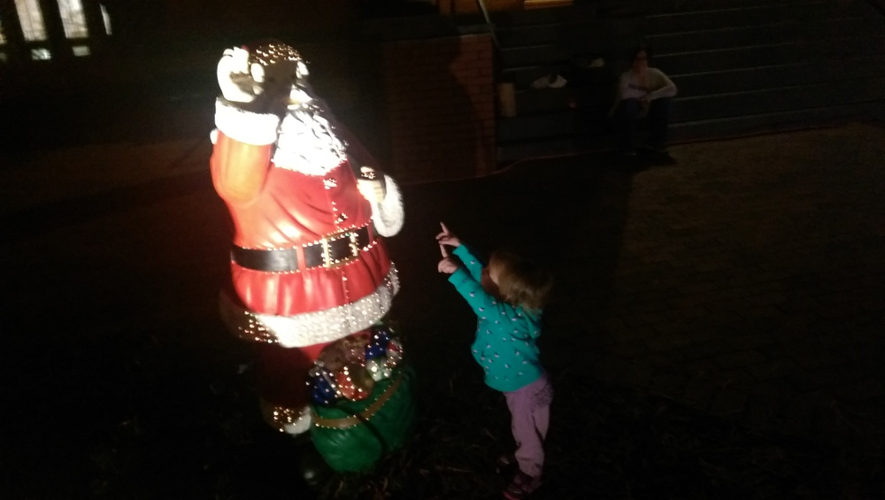 "Cece saying ""Hi"" to Santa on the lawn of the Leesburg Town Hall during the parade."