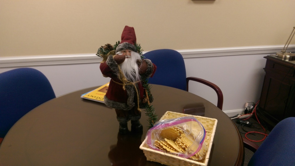 Santa guarding the pizzelles in my office.