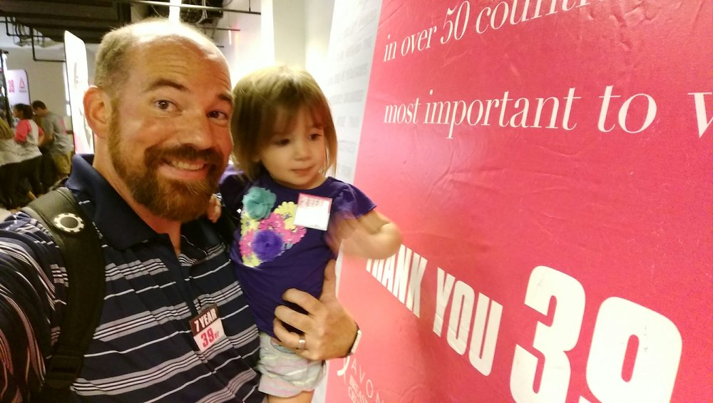 Checking out the sign at event eve. My button says 7 years and Cece's says 2 years.