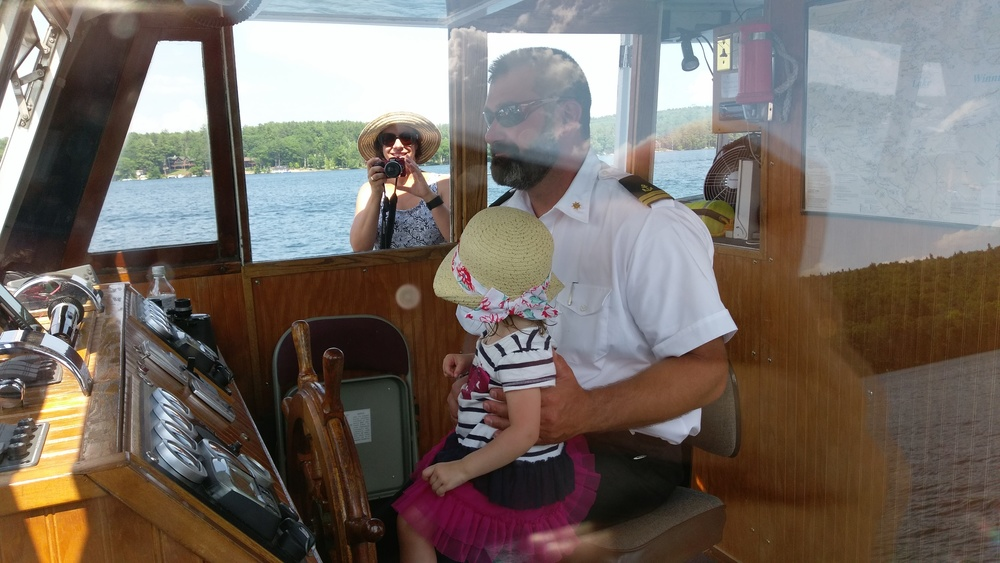Cece driving the boat