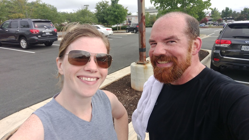 My friend Melanie and me in the parking lot of Orange Theory