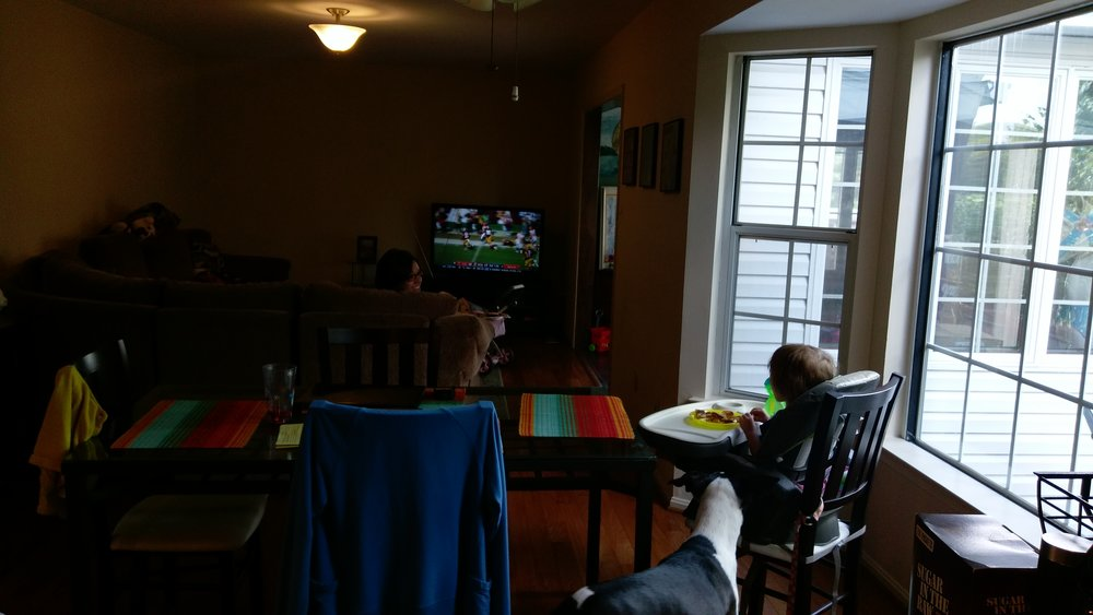 Girls watch football while I wash dishes