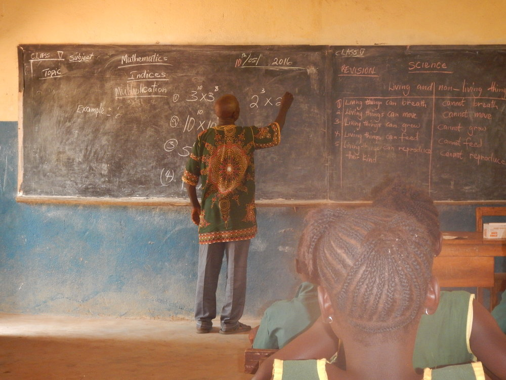 A dedicated math teacher at Koromasilaia Primary School, a CAUSE Kids sponsored   school in Sierra Leone.