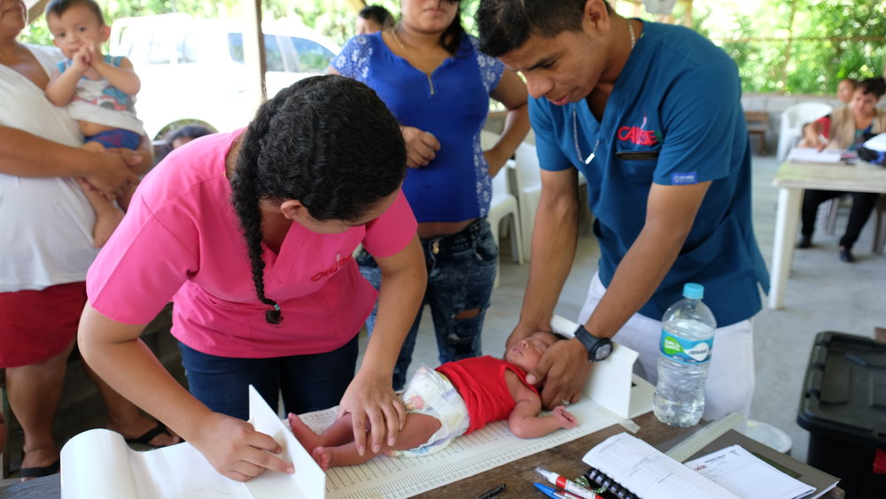 Measuring and weighing a baby at a Maternal and Newborn Centre in Honduras.