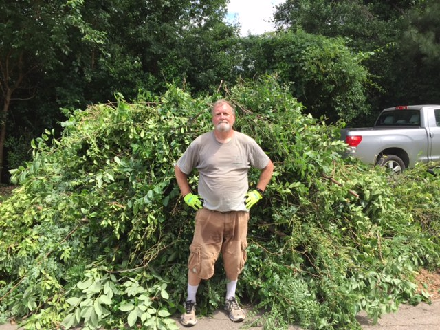 Bill Rehberg cleaning up tree damage.JPG