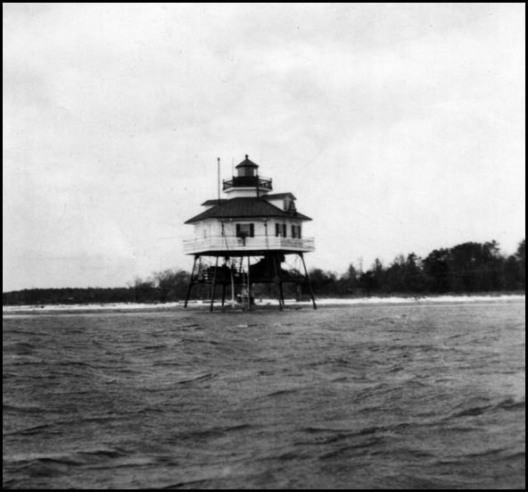 View of the lighthouse from off-shore with what is now the Drum Point Club grounds in the background.