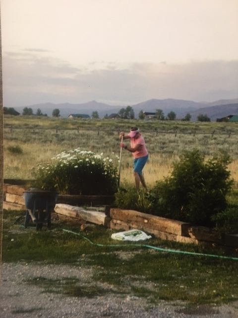 My mom working in one of her many gardens.