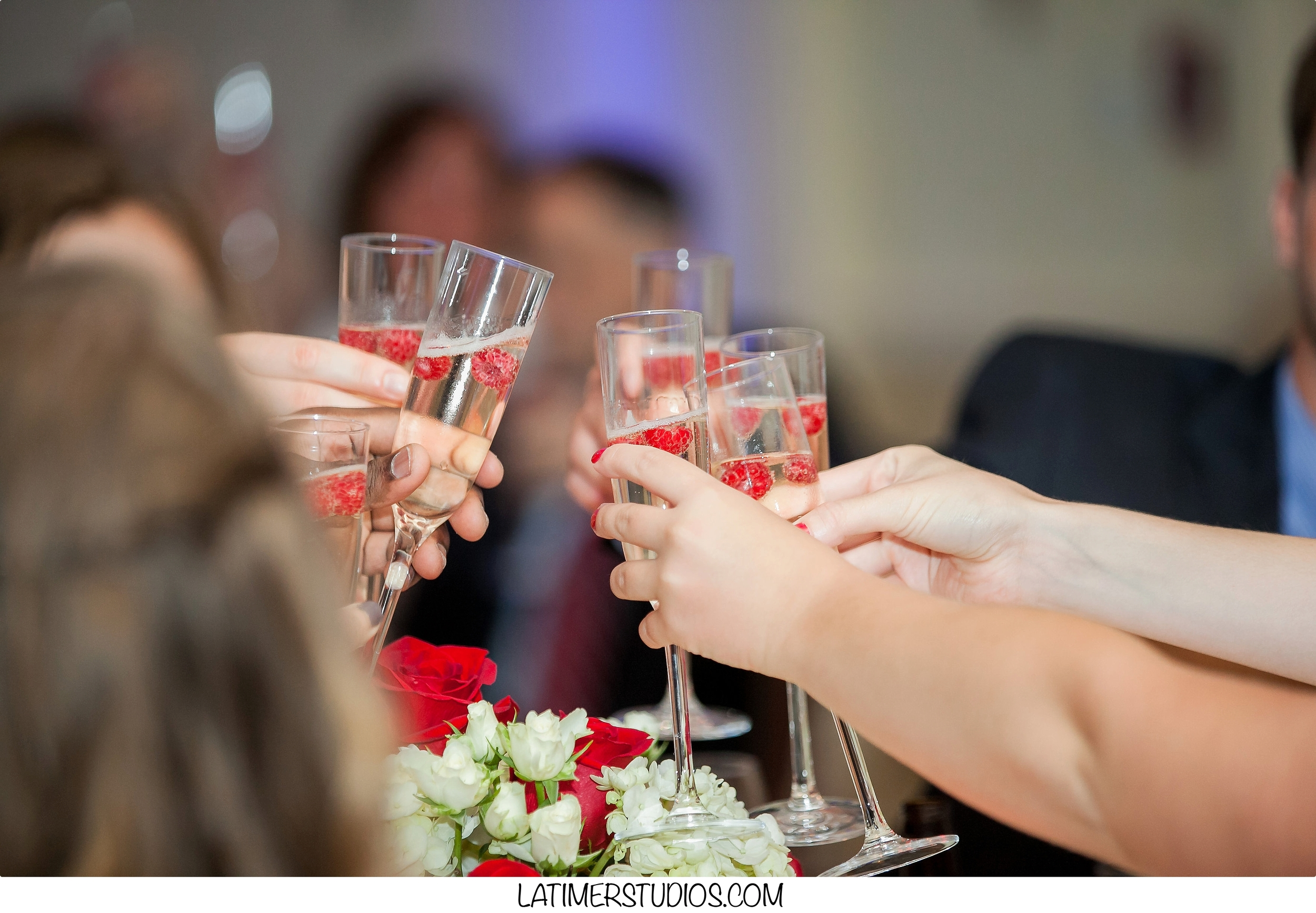 Latimer Studios Photography capturing a toast at Wentworth by the Sea in Rye NH