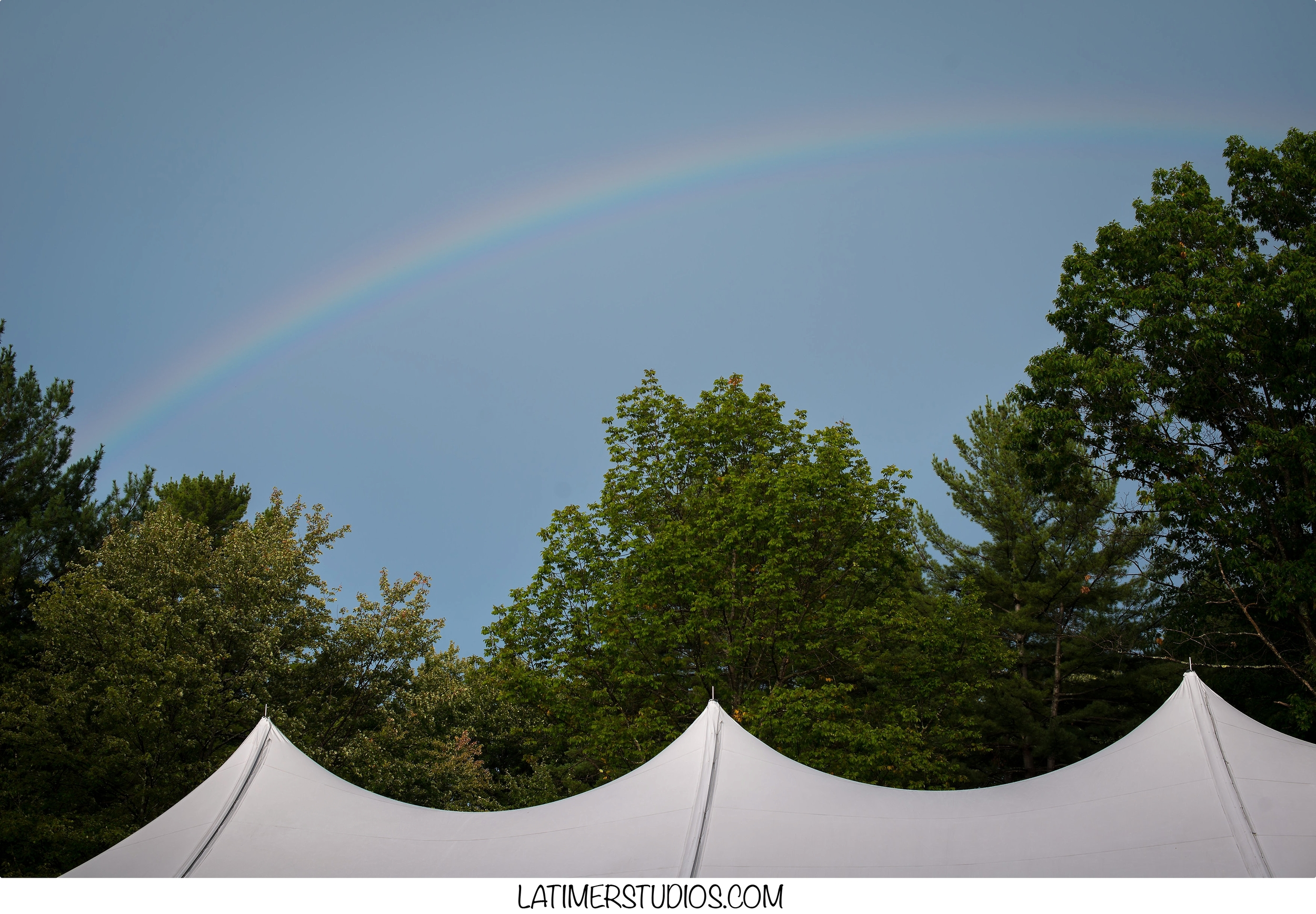Latimer Studios Photography capturing  a rainbow at a wedding at Mile Away Restaurant in Milford NH