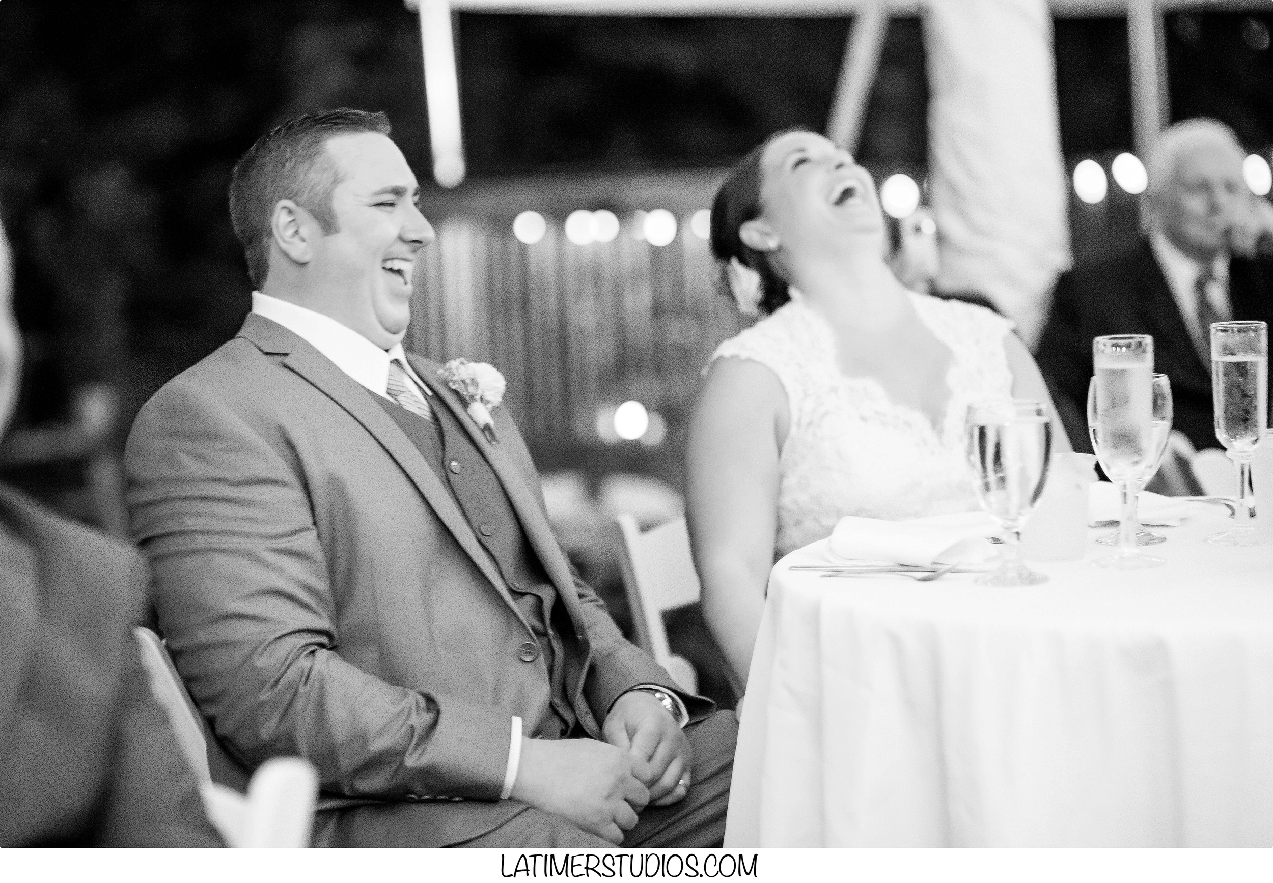 Latimer Studios Photography capturing  a toast at a wedding at Mile Away Restaurant in Milford NH